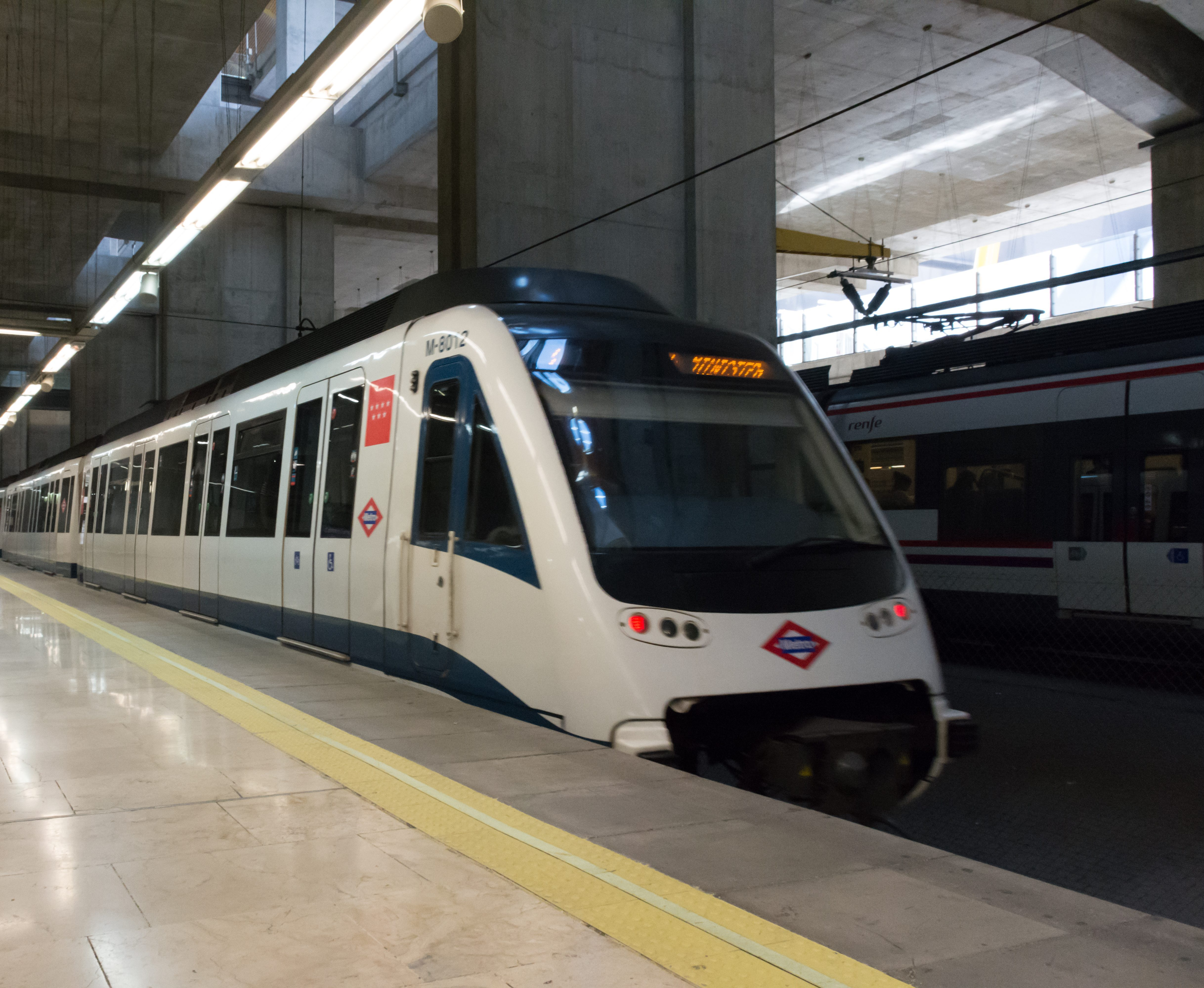 Madrid airport metro train arriving at the airport