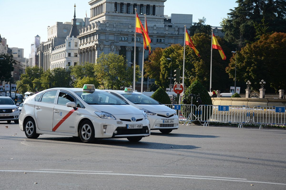 Madrid airport white taxis arriving at the airport