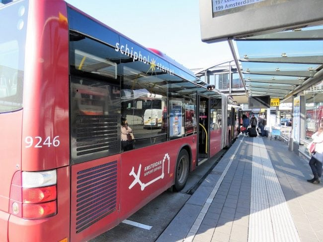 Connexxion's 197 Amsterdam Airport Express bus waiting on the platform