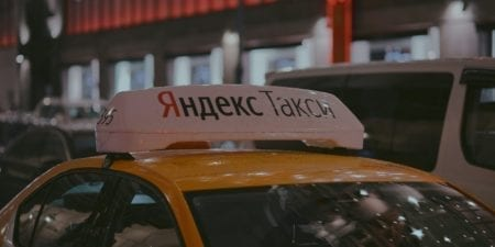 yellow Moscow taxi with big roof sign