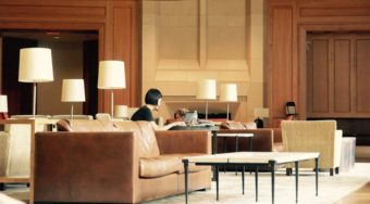 woman working on laptop in hotel lobby